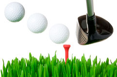 Golf club hitting the ball. Golf club hitting a ball on tee after a perfect swing isolated on white background. Each ball is easily removable Stock Photo