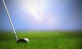 Golf club hitting golf ball. Along fairway towards green with copy space Royalty Free Stock Photos