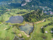 Golf Club with Lakes Malaysia shot by drone. Golf Club Field in Malaysia shot by drone on top angle, in morning sun light, with 2 lakes within stock photos