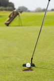 Golf club putting ball at the hole Stock Photography