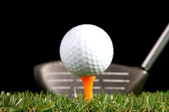 Golf club ready to hit golf ball Stock Image