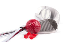 Golf club with red ball and tees on white background Stock Photography