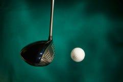 Golf club striking ball Stock Image