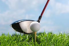 Golf club teeing up to hit ball Royalty Free Stock Photos