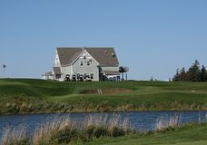 Golf Clubhouse. Clubhouse overlooks the water hazard Royalty Free Stock Image