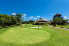 Golf Clubhouse. Green and holes in front of Golf clubhouse in Bali, Indonesia Stock Photography