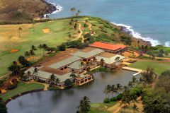 Golf Clubhouse in Kauai. Aerial view of golf clubhouse on Pacific coast on the island of Kauai, swimming pool is in front of building, there is palm trees and Stock Photos