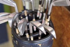 Golf clubs. Bag upper view with very selective focus on the lowest right club Stock Images