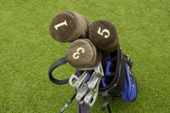 Golf clubs 2. The detail of the golf-clubs in a bag on the green stock image