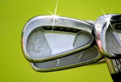Golf Clubs. Bright and shinny golf clubs on green background stock images