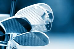 Golf Clubs. New golf clubs in blue color tone stock photo