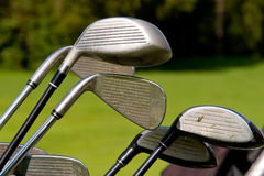 Golf clubs. On the green grass background royalty free stock photo