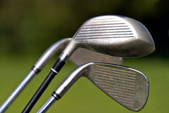 Golf clubs. On a green background stock image