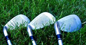 Golf Clubs. Resting on the grass Stock Image