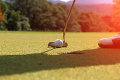 Golf clubs and golf ball in golf course. Golf clubs andg olf ball on golf course in thailand Stock Photography