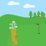 Golf clubs and bag on the course Stock Photo