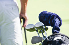 Golf Clubs. In bag, with player standing in background Stock Images