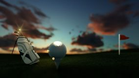 Golf clubs and ball on tee with red flag against beautiful timelapse sunrise, focus shift, zoom out stock video footage