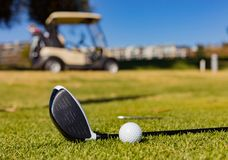 Golf Clubs and Balls on a Golf Course royalty free stock image