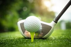 Golf clubs and golf balls on a green lawn in a beautiful golf course royalty free stock photo