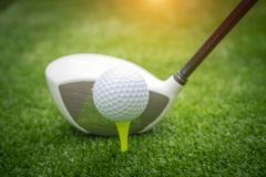 Golf clubs and golf balls on a green lawn in a beautiful golf course stock images