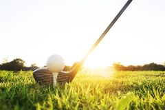 Golf clubs and golf balls on a green lawn stock photos