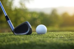 Golf clubs and golf balls on a green lawn in a beautiful golf course royalty free stock photos