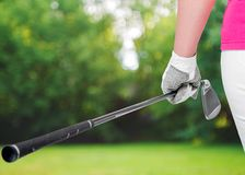 Golf clubs close up in hands the athlete Royalty Free Stock Photo
