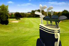 Golf clubs on a course Royalty Free Stock Photos