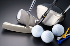 Golf clubs, driver, iron, putter, balls and tees. Royalty Free Stock Images