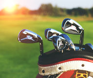 Golf clubs drivers over green field background Stock Photography