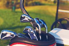 Golf clubs drivers over green field background Royalty Free Stock Photos