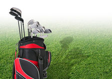 Golf clubs in front of faded tee box grass Royalty Free Stock Photo
