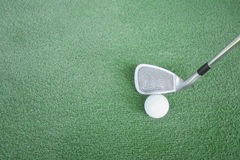 Golf clubs and golf balls on green artificial grass At the golf. Driving range Stock Photos