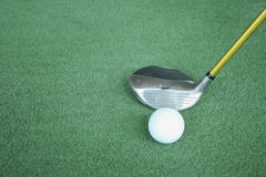 Golf clubs and golf balls on green artificial grass At the golf Royalty Free Stock Photos