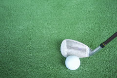 Golf clubs and golf balls on green artificial grass At the golf. Driving range Royalty Free Stock Photography
