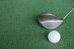 Golf clubs and golf balls on green artificial grass At the golf. Driving range Stock Photography