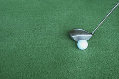 Golf clubs and golf balls on green artificial grass At the golf. Driving range Stock Image