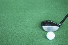 Golf clubs and golf balls on green artificial grass At the golf. Driving range Royalty Free Stock Photo