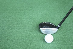 Golf clubs and golf balls on green artificial grass At the golf stock image