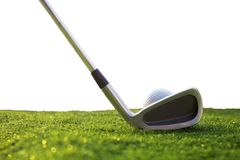 Golf clubs and golf balls on green grass isolated from a white background royalty free stock photography