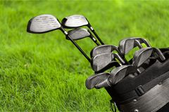 Different golf clubs on blurred background. Golf clubs golf club game sport leisure fun Stock Images
