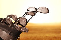 Different golf clubs on blurred background. Golf clubs golf club game sport leisure fun Royalty Free Stock Images