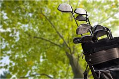 Different golf clubs on blurred background. Golf clubs golf club game sport leisure fun Stock Image