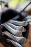 Golf clubs in golf course Stock Photos