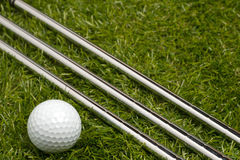 Golf clubs or golf irons with a golf ball Stock Photo