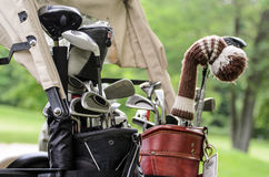 Golf clubs in golfbag. Golf cart with clubs on golfcourse Stock Photography