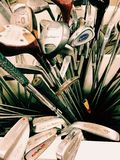 Golf clubs. Lots of old metal golf clubs stock photo