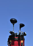 Golf Clubs in a Red Bag. Putter, irons, driver and 3 wood, vertical, copy space Royalty Free Stock Photos