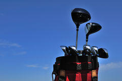 Golf Clubs in a Red Bag. Putter, irons, driver and 3 wood, copy space Stock Photo